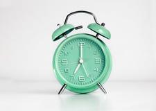 Green analog retro twin bell alarm clock Royalty Free Stock Photos