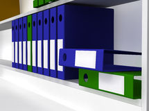 Green And Blue Folders Laying On Shelf Stock Image