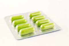 Green antibiotic in blister Royalty Free Stock Image