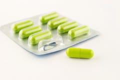 Green antibiotic in capsule Stock Images