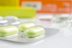 Green antibiotic in capsule Royalty Free Stock Image