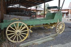 Antique Green Studebaker Farm Wagon in Dufur, Oregon. This is a green antique farm wagon with yellow wheels made by Studebaker on display in Dufur, Oregon stock images