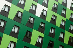 Green Apartment Building angled. New environmentally friendly eco unit building complex. Angled view showing shades of green angled panels royalty free stock photos