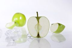 Green apple. Green half apple and ices Stock Images