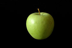 Green apple. A green apple black background Royalty Free Stock Photos