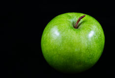 Green apple. On black background Royalty Free Stock Images