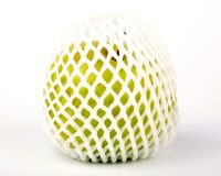 Green Apple. A green apple covered for safety bag Stock Images