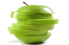 Green apple. Overlapped slices of green apple Royalty Free Stock Photography