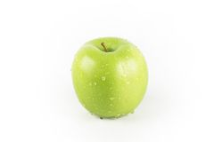 Green apple. Fresh green apple greenstar with water drops Royalty Free Stock Images