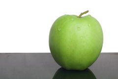 Green apple. Green juicy apple with water droplets the useful Stock Image
