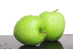 Green apple. Green juicy apples with water droplets the useful Royalty Free Stock Image