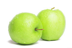 Green apple. Green juicy apples with water droplets on a white background Stock Image