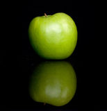Green apple. On a black nackground Stock Photography