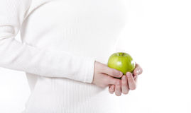 Green Apple. Womans hands holding a grannysmith green apple royalty free stock photo