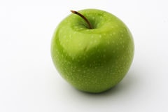 Green Apple. A green apple with stem Royalty Free Stock Photography