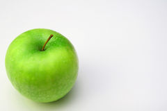 Green apple. Tasty green apple on the white background Royalty Free Stock Photos