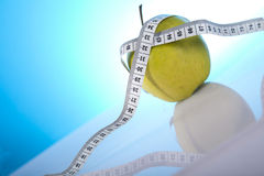 Green apple. With white measure tape on a table Royalty Free Stock Image