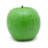 Green apple-2. Ripe green applecovered by water droplets. Isolation on white Stock Photos