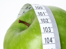 Green Apple. With tape measure Royalty Free Stock Photography