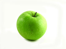 Green apple. Just a green and healthy apple on white background Royalty Free Stock Photo