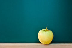 Green apple. On empty chalkboard, add text to chalkboard Royalty Free Stock Photos