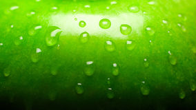 Green apple. Drops on green apple, close-up Royalty Free Stock Photos