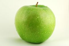 Green Apple. A green apple on a white background royalty free stock photos