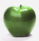 Green apple. Tasty green apple on isolated white background Stock Photos