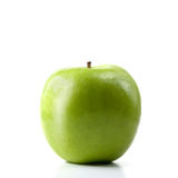 Green Apple. Studio image of a green apple isolated against a white background. Copy space stock photo