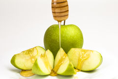 Green Apple. And honey  on white background Stock Photos