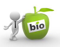 Green apple. 3d people - man, person with an green apple. Concept of bio Royalty Free Stock Photos