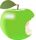 Green Apple. Green apple was  bitten with leaf Royalty Free Stock Photography