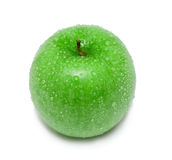 Green apple-3. Fresh ripe green apple covered by water drops. Isolated Royalty Free Stock Photo