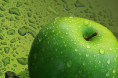 Green apple. With wet background Stock Photography