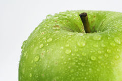 Green apple. Apple with water drops stock images