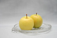 Green apple. Two green apples on a plate stock images