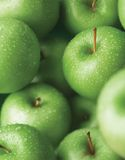 Green apple. With water drop, swallow depth of field Royalty Free Stock Photo