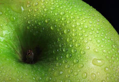 Green apple. Fresh green apple with raindrops stock photography