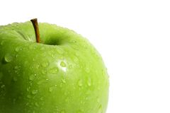Green apple. The green apple is covered by water drops Stock Images