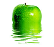 Green apple. Green jucy apple. Reflection in water Stock Images