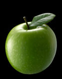 Green apple. With single leaf on dark background Stock Photo