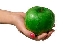 Green apple. In a hand royalty free stock photo