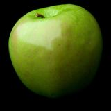 Green apple. On black backround Royalty Free Stock Photo