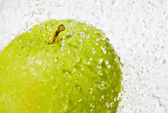 Green apple. With drop of water isolated on white background Stock Photo