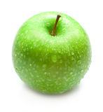 Green apple. Covered by water drops on the white background. Isolated. Shallow DOF Stock Image