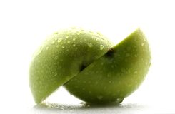 Green Apple. A macro close up of a green apple covered in water droplets stock photography