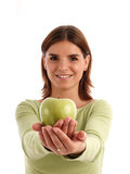 Green apple. Young woman holding green apple stock image