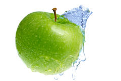 Green apple. Green fresh apple and blue water Royalty Free Stock Image