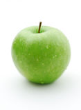 Green apple. Juicy ripe green apple on a white background Stock Photography
