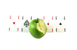 Green apple with aces Royalty Free Stock Images